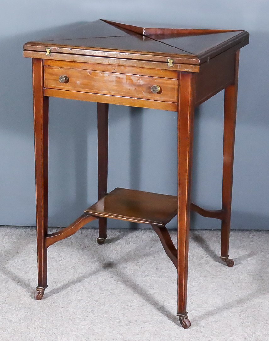 An Edwardian Mahogany Square Envelope Card Table, the top inlaid with boxwood stringings and