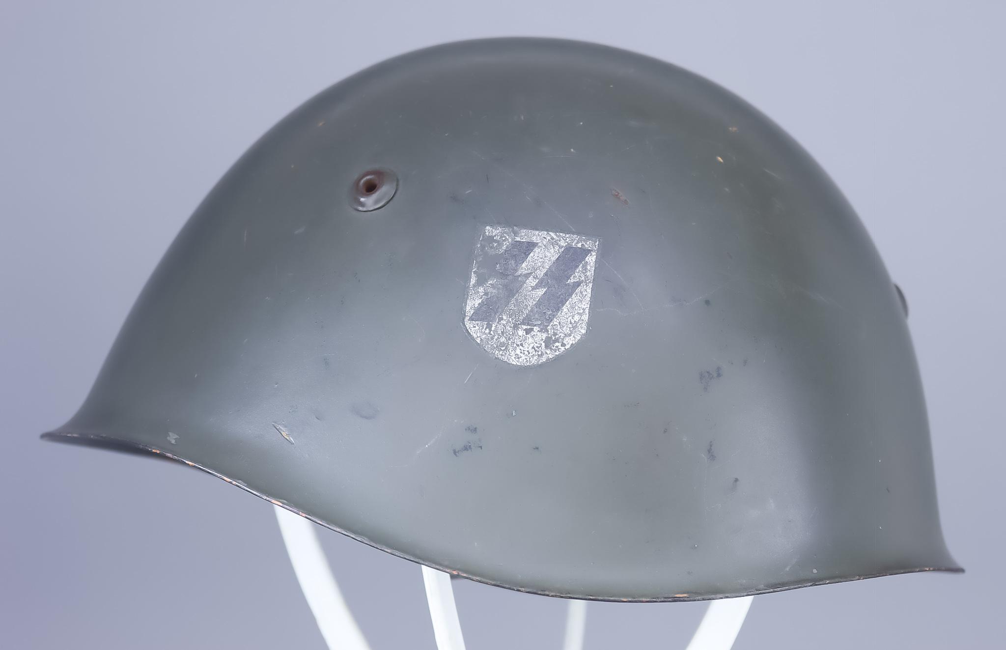 An Italian or Croatian Helmet, painted, with single SS decal