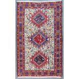 """A Modern Soumak Rug of """"Persian"""" Design, woven in colours with three bold shaped medallions, the"""