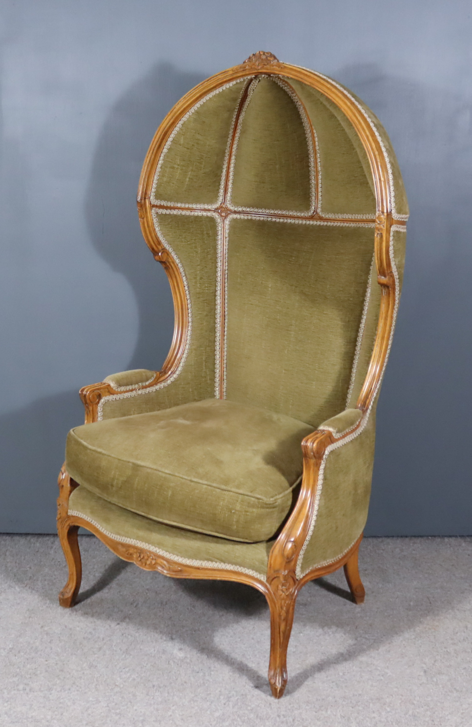 """An Early 20th Century French Beechwood Framed """"Porters"""" Armchair, the whole with moulded showwood"""