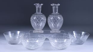 A Pair of Bulbous Glass Carafes with Trefoil Necks, a Pair of Rinsers, and Fifteen Finger Bowls, the