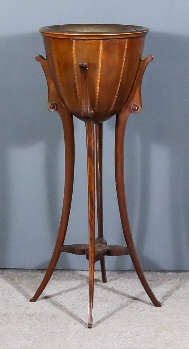 An Edwardian Inlaid Mahogany Circular Jardiniere, with brass liner, on four shaped supports, 14ins