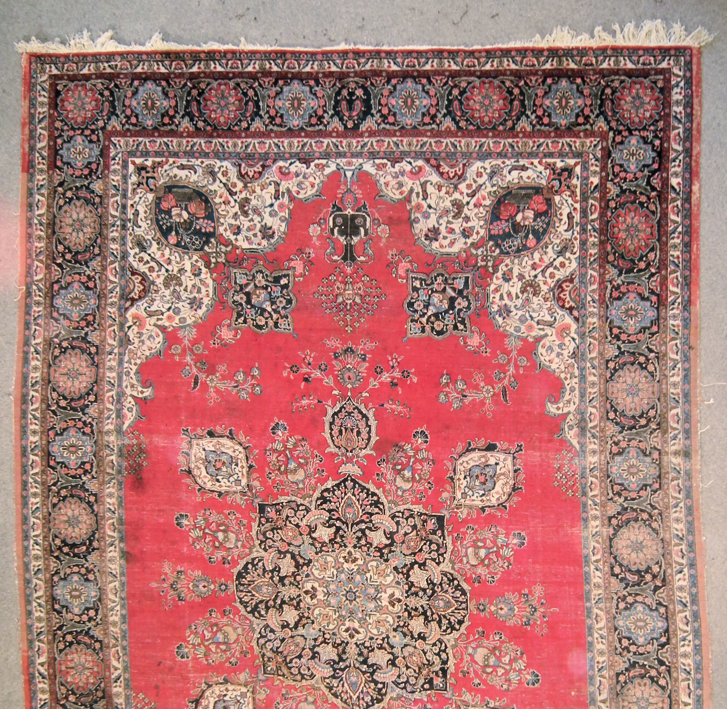A Meshad Carpet, Early to Mid 20th Century, woven in colours with central star shaped medallion