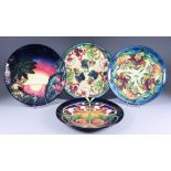 A Moorcroft Pottery Year Plate for 1998, No. 570 of 750, a year plate for 1999, No. 337 of 750,