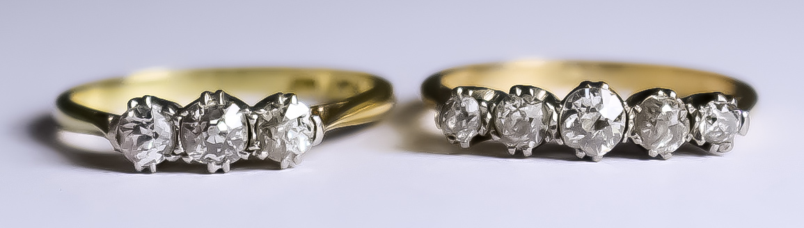 A Five Stone Diamond Ring and a Three Stone Diamond Ring, 20th Century, both 18ct gold, the five