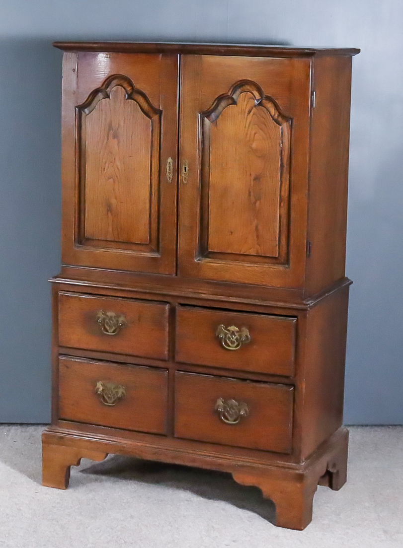 """A Small Oak Cabinet of """"18th Century"""" Design, the upper part fitted one shelf enclosed by a pair"""