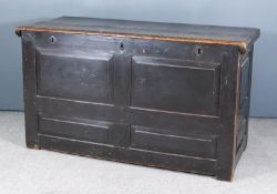 An 18th Century Panelled Oak Coffer, the two-piece top with moulded edge and with twin fielded