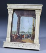 """I* A Continental Carved Ivory Frame of Renaissance """"Tabernacle"""" Form, 19th Century, containing a"""