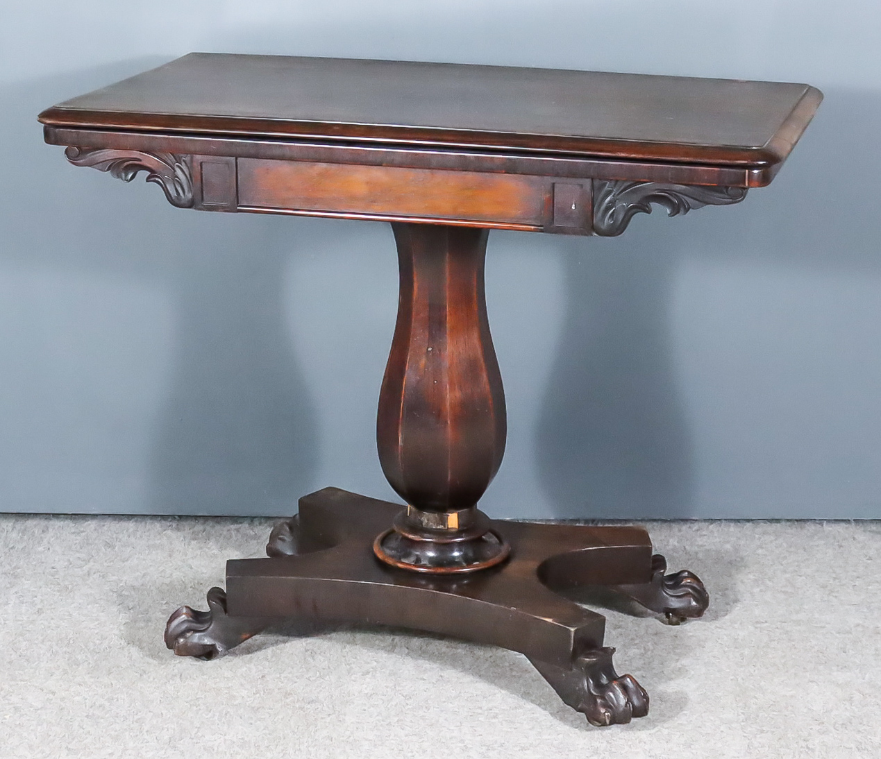 A William IV Rosewood Rectangular Card Table, the baize lined folding top with moulded edge, on