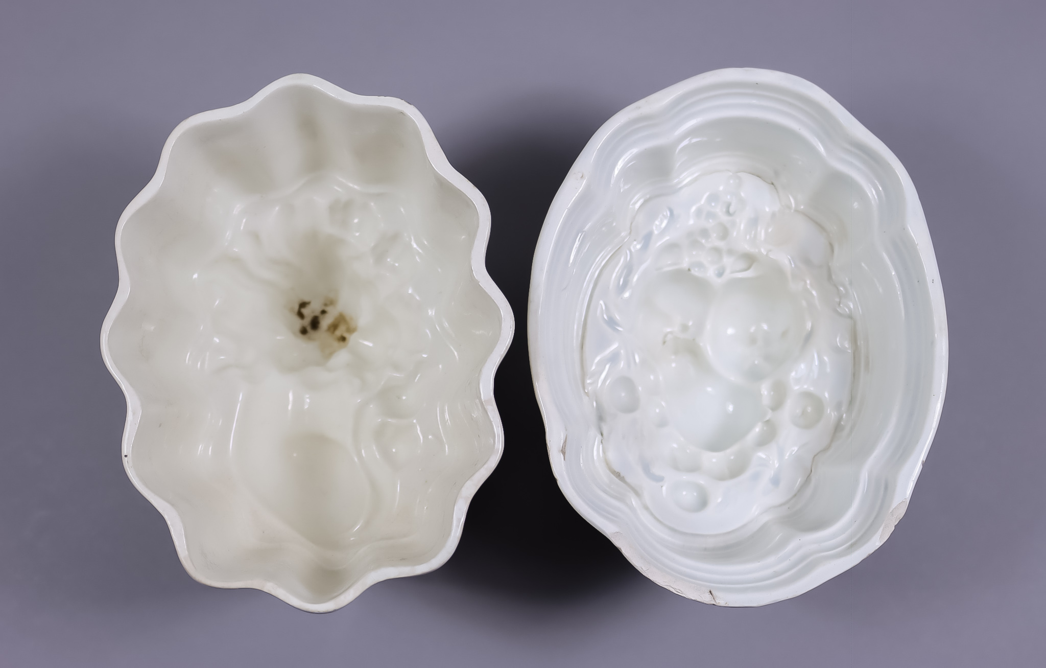 Six Pottery Jelly Moulds, Mid/Late 19th Century, including - one with lion, 6.25ins x 4.75ins x 4.
