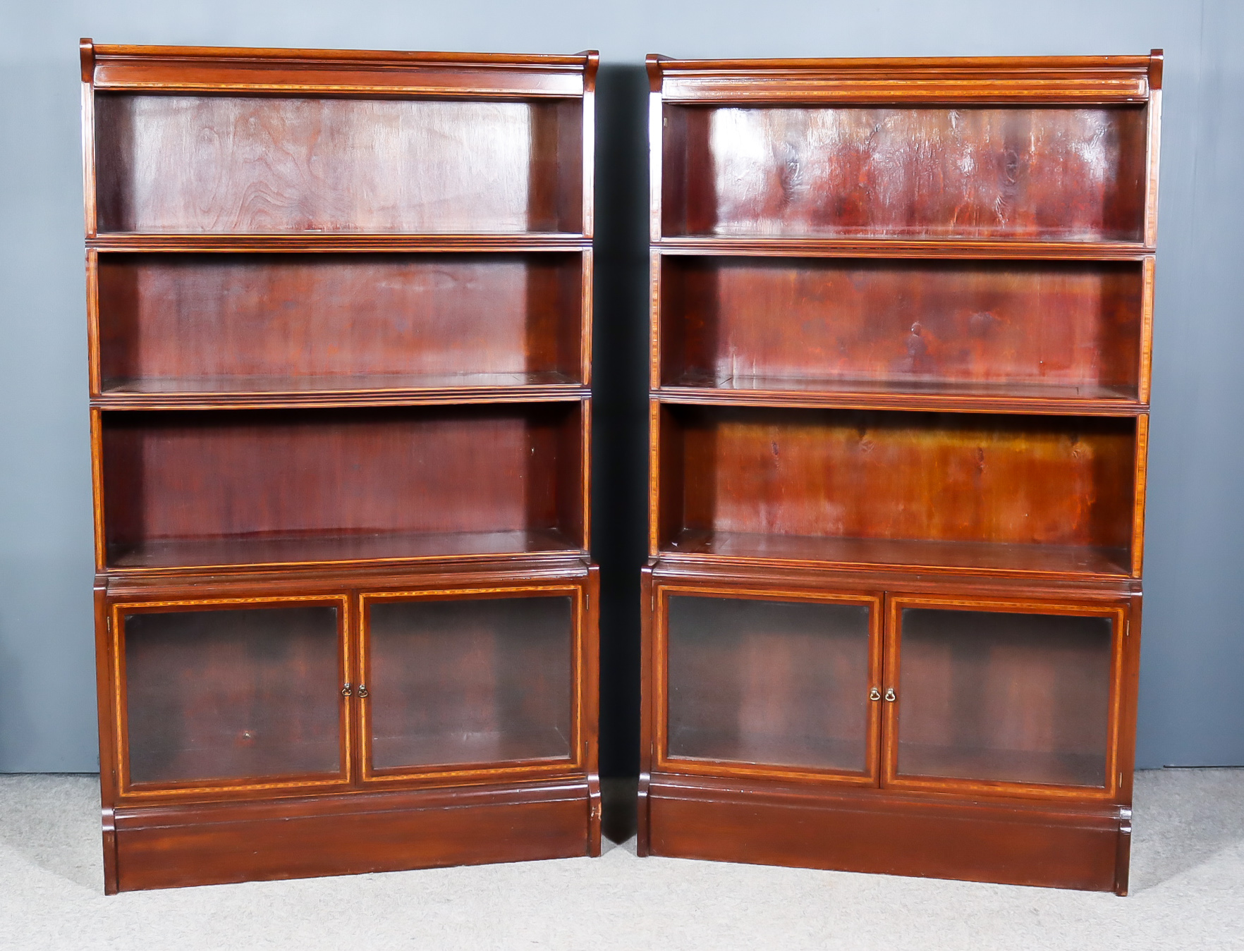 A Pair of Early 20th Century Mahogany Bookcases, designed and manufactured by William Baker & Co. of