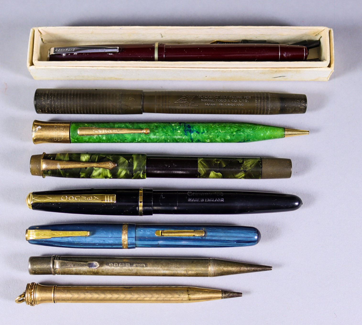 A Quantity of Writing Implements, comprising - three propelling pencils, one silver, one by Schefer,