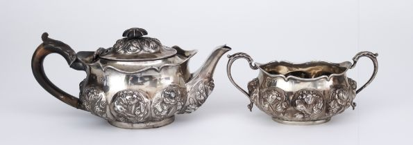 A Victorian Silver Oval Teapot and Two-Handled Sugar Basin, by William Comyns & Sons, London 1892