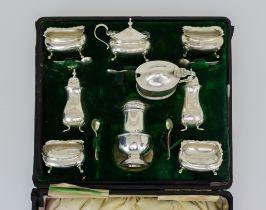 An Edward VII Silver Part Condiment Set, various makers, Birmingham 1905, with shaped rims,