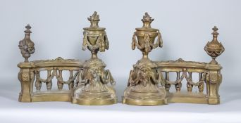 A Pair of Continental Cast Brass Chenet, modelled as balustrades with lion masks, and urn and swag