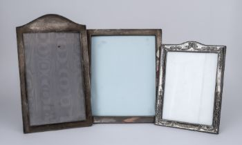 Three George V Silver Rectangular Photograph Frames, one with arched top, By Mappin & Webb,