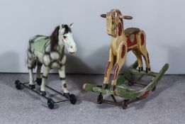 A Child's Dappled Grey Push-Along Horse, on black metal frame base with wheels, 22ins overall x