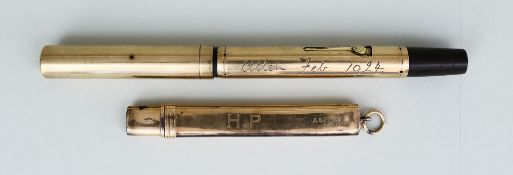 """A Waterman's 9ct Gold Cased Fountain Pen and a 9ct Gold Cased Pencil, the fountain pen engraved """""""