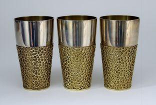 Three Elizabeth II Silver and Silver Gilt Beakers, by Stuart Devlin, London 1970, each of plain