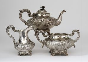 A Victorian Silver Circular Three Piece Tea Service, by William Hunter, London 1845, of compressed