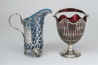 A Victorian Silver Milk Jug and a George V Silver Sugar Basket, the milk jug by Cartwright, Hirons &