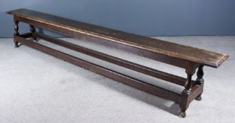A 19th Century Oak Bench, with moulded edge to top, on baluster turned legs and with turned feet and