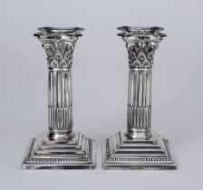 A Pair of Edward VII Silver Pillar Candlesticks, by William Hutton & Sons Ltd, London 1906, with