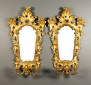 A Pair of Carved and Gilt Wood Three-Branch Girandoles of Baroque Inspiration, Late 19th/Early