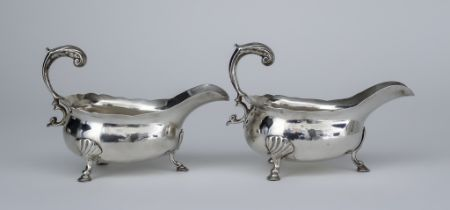 A Pair of 18th Century Silver Sauce Boats, hallmarks rubbed, with shaped rims, leaf capped flying