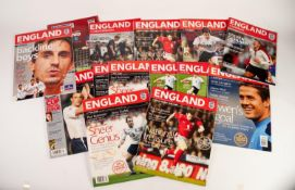 FOURTEEN ENGLAND HOME PROGRAMMES PLAYED AT OLD TRAFFORD, to include Spain, Poland, Greece, etc.