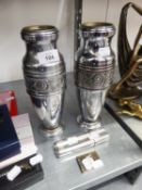 TWO ELECTROPLATED CIGAR CASES, CIGAR CUTTER AND A PAIR OF EMBOSSED METAL VASES