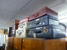 ELEVEN VARIOUS SUITCASES