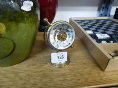 A SMALL BRASS AND GLASS GLOBE CLOCK WITH VISIBLE MECHANICAL MOVEMENT, 4? HIGH