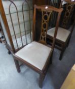 A SET OF FOUR MAHOGANY DINING CHAIRS WITH PIERCED SPLAT BACKS, DROP-IN SEATS, ON STRAIGHT FRONT