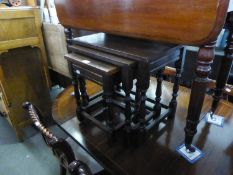 A NEST OF THREE OAK OBLONG COFFEE TABLES, OF JACOBEAN STYLE
