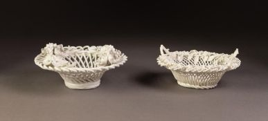 FLORAL ENCRUSTED PORCELAIN BASKET, of circular wire pattern with four upright loop handles to the