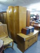 A 1950's SATIN WALNUTWOOD WARDROBE AND DRESSING CHEST (BOTH A.F.)