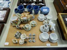 FIVE CERAMIC DOLLS TEA SETS OR PART SETS AND A CHINA DOLLS HOUSE MINIATURE TEA SET OF 15 PIECES