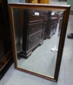 A MODERN UPRIGHT BEVELLED EDGE WALL MIRROR, IN MAHOGANY FRAME WITH GILT SLIP