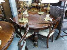 A SET OF FOUR MAHOGANY VICTORIAN STYLE DINING CHAIRS WITH BALLOON VARIANT BACKS AND THE MAHOGANY