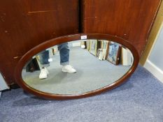 A LARGE OVAL BEVELLED EDGE WALL MIRROR, IN MAHOGANY FRAME, 3?1? HIGH, 2?3? WIDE OVERALL