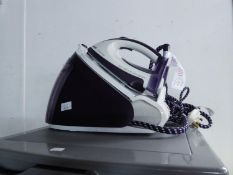 PHILIPS DOCKING STEAM IRON  AND A DELONGHI RADIATOR (2)