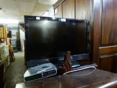 A SMALL SONY FLAT SCREEN TELEVISION AND A ROBERTS RADIO/ALARM CLOCK