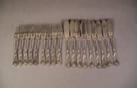 NINE PAIRS OF AESTHETIC MOVEMENT ELECTROPLATED FISH EATERS, with floral embossed handles, (18)