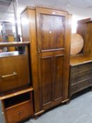 a 1930's CARVED OAK HALL WARDROBE