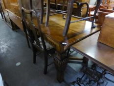 ELIZABETHAN STYLE MEDIUM OAK OBLONG DRAW-LEAF DINING TABLE WITH FLUTED FRIEZE, ON FOUR HEAVY