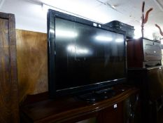 PANASONIC VIERA FLAT SCREEN TELEVISION, ON MAHOGANY FALL FRONT STAND AND THE SYMPHONIC VIDEO