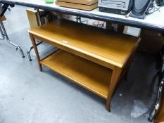 A TEAK TWO TIER COFFEE TABLE, HAVING PULL-OUT SHELVES TO EACH SIDE (51cm high x 90cm wide x 46cm)