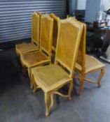 A SET OF SIX LIGHTWOOD DINING CHAIRS WITH CANE BACKS AND SEATS AND 'X' STRETCHER (6)