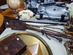 A PAIR OF OLD BRASS AND STEEL LONG FIRE TONGS AND MATCHING SHOVEL, TWO SIMILAR ALL STEEL ITEMS AND A